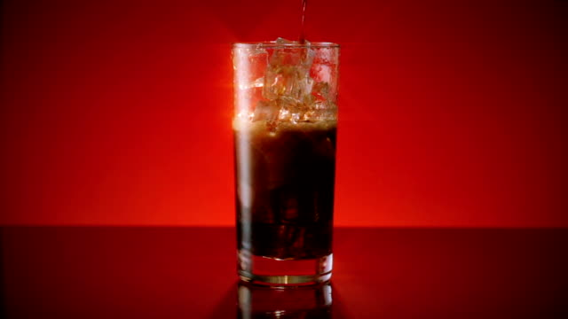 Cola Soda Pouring in Ice Wide Star Filter