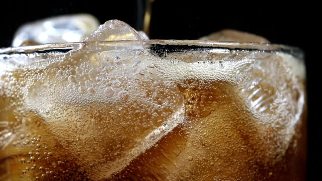 Cola with ice cube black background Cola with ice cube black background studio shot cola stock videos & royalty-free footage