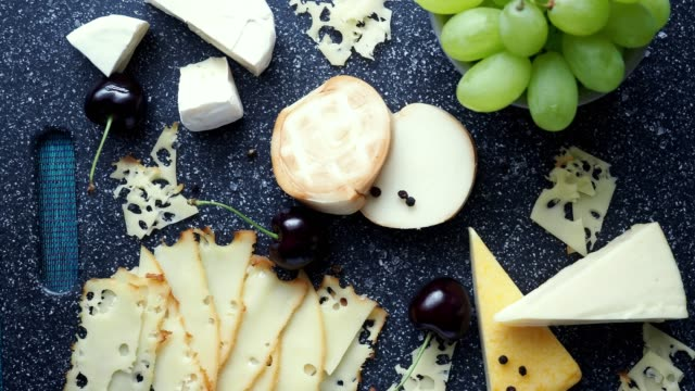 cold appetizer. cold cuts. cheese on cutting board isolated on blue background, top view - french food stock videos and b-roll footage