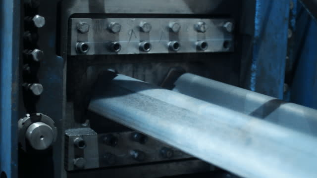 Cold rolled steel profile with zinc coating and holes. Industrial metalworking