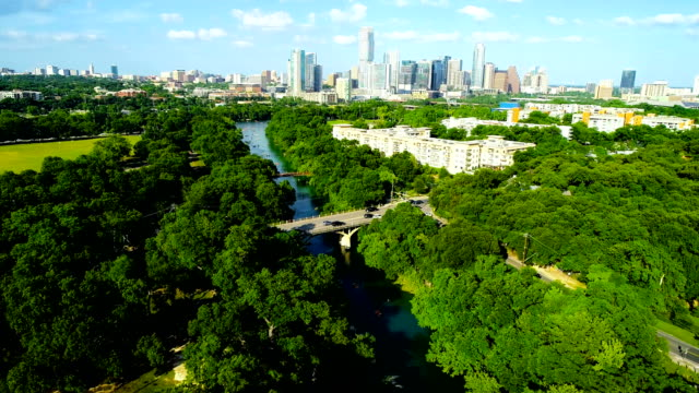 Cold Spring Barton Creek Flows towards Austin Texas Cityscape