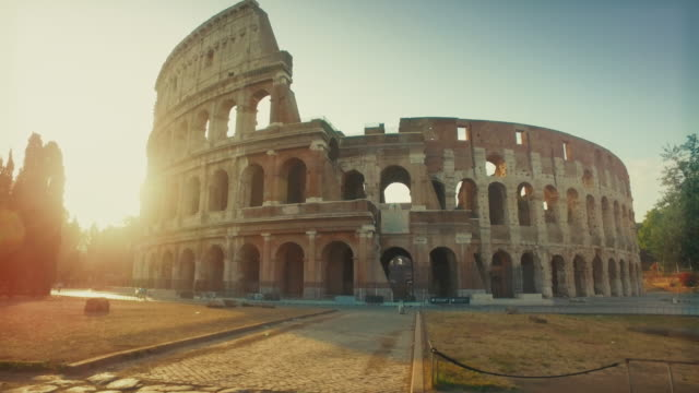coliseum of rome with warm sun at early morning - obiekt światowego dziedzictwa unesco filmów i materiałów b-roll
