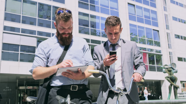 DS Colleagues using modern devices in front of the office building video