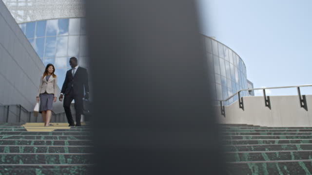 Colleagues Walking on Stairs Outside of Office Building video