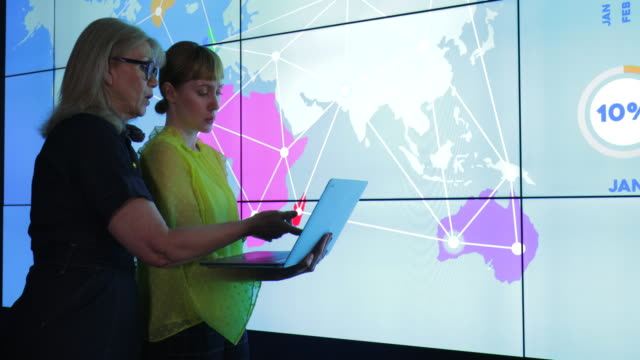 Colleagues with Interactive Information Wall