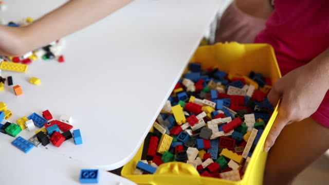Collecting toy blocks Video of kids collecting toy blocks and leaving them in the box after playing playroom stock videos & royalty-free footage