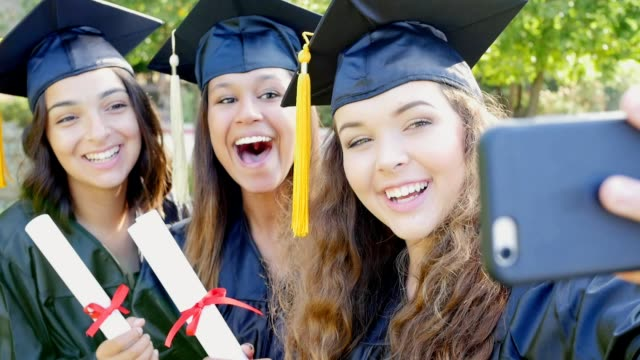 college friends make faces while posing for selfies after graduation - student life stock videos and b-roll footage