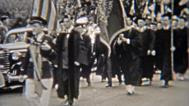 1937: College graduation parade in full gowns from the university. video