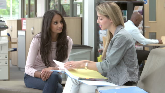 College Student Having Meeting With Tutor To Discuss Work video