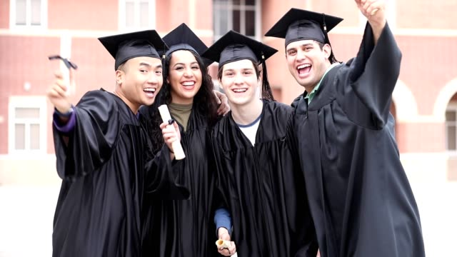 College students excitedly show off diplomas after graduation ceremony. video