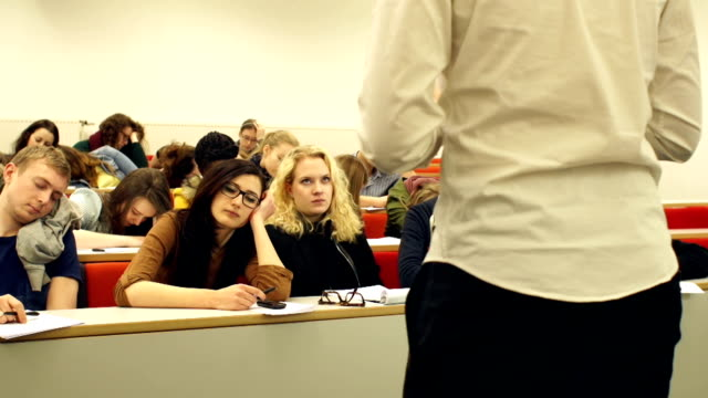College Students falling asleep in boring University Lecture Hall video