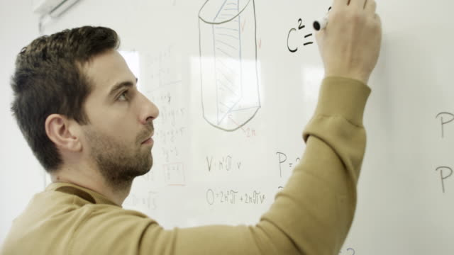 College students College students solving problem. whiteboard visual aid stock videos & royalty-free footage