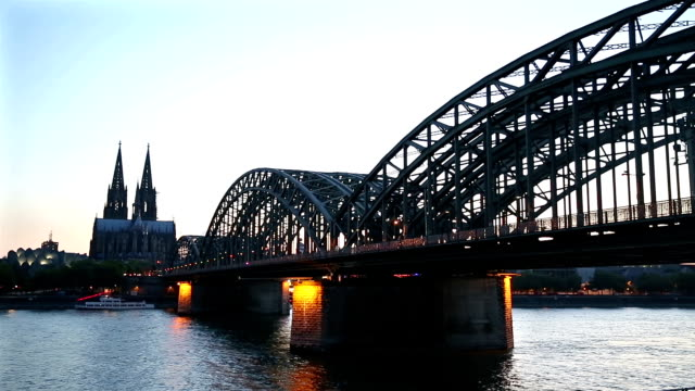 Cologne Cathedral and Hohenzollern Bridge at dusk Germany video