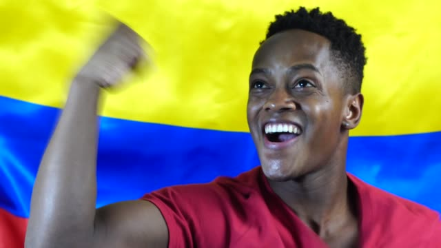 Colombian Young Black Man Celebrating with Colombia Flag video