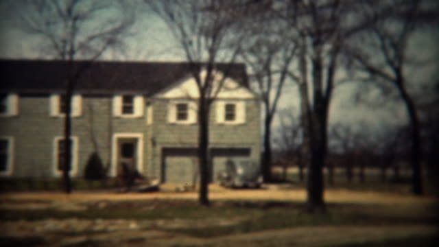 1937: Colonial style architecture modern house in wooded rural country. video
