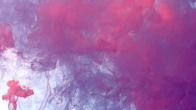 color drop in water, ink swirling in water. cloud of silky ink in water isolated on black background. colorful ink in water, ink drop. violet, blue, pink. - balance graphics video stock e b–roll