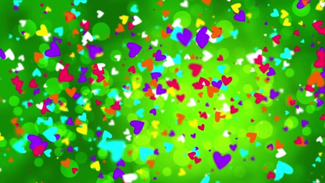 Color falling hearts on a green background - vídeo