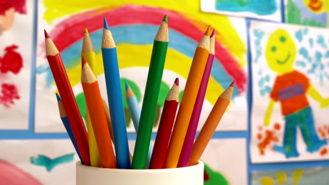 Color Pencils In Classroom With Paintings On Wall video