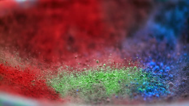 SLO MO color pigments vibrating into the air video