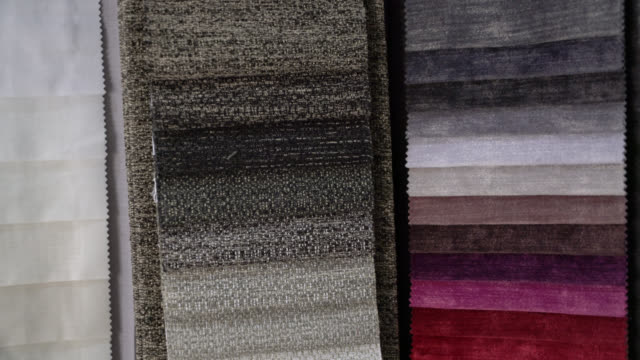 Color swatch of different textiles at a  shop Color swatch of different textiles at a  shop fabric swatch stock videos & royalty-free footage