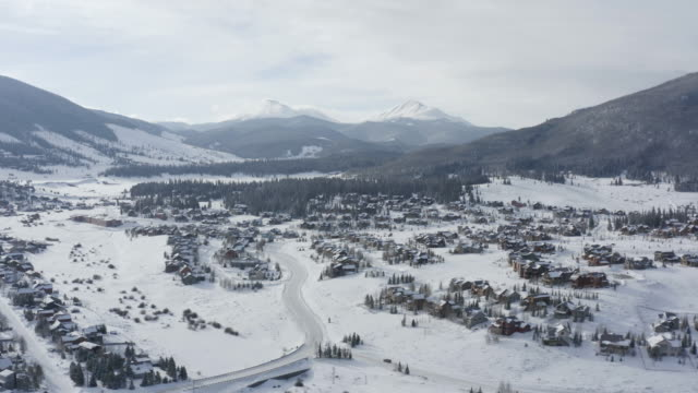 Colorado Mountain Town Summit County Aerial Flyover Winter Snowy Day Two Peaks
