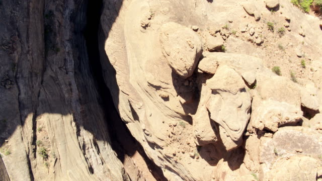 colorado river flowing through slot canyon in utah - drone shot - rock formations stock videos & royalty-free footage