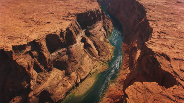 AERIAL Colorado River running through the canyon in sunshine
