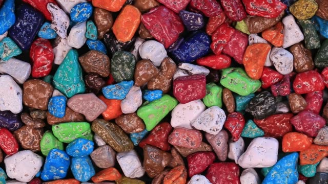 colored candy made in the form of pebbles sold in the store in egypt, close up - group of people стоковые видео и кадры b-roll