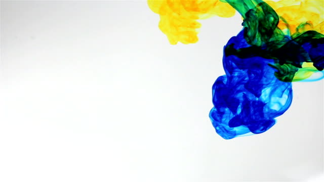 Colored ink cloud grows in water video