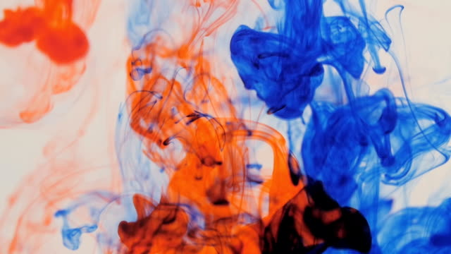 Colored ink explosion on white background video