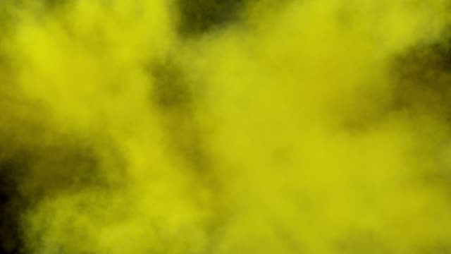 Colored middle size smoke explosion with trails, expands towards the camera. Separated on pure black background, contains alpha channel. yellow stock videos & royalty-free footage