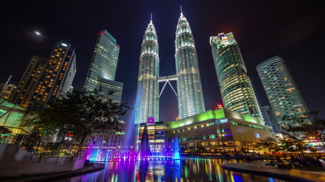 colored night light famous towers fountain 4k time lapse from kuala lumpur - malese video stock e b–roll