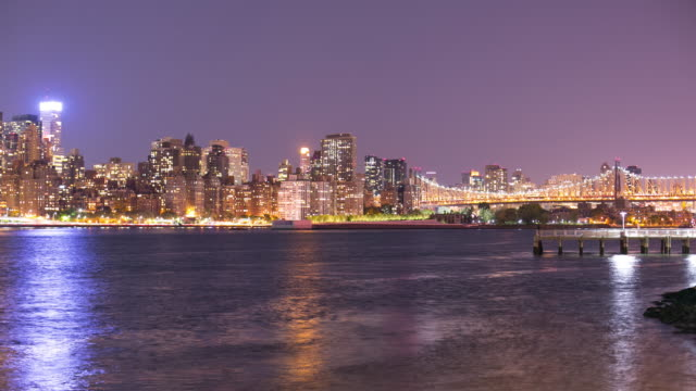 colored night light manhattan 4k time lapse from queens nyc video