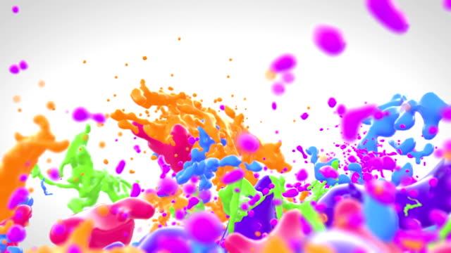 farbige farbspritzer in zeitlupe - bunt farbton stock-videos und b-roll-filmmaterial