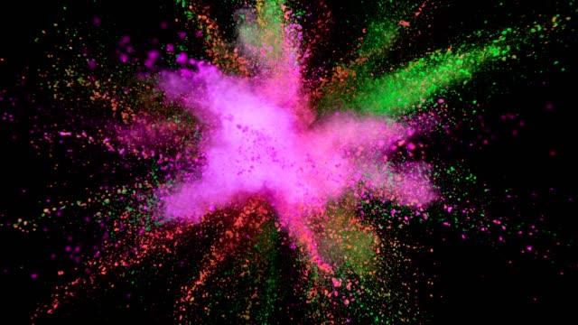 colored powder explosion on black background. - happy holidays filmów i materiałów b-roll