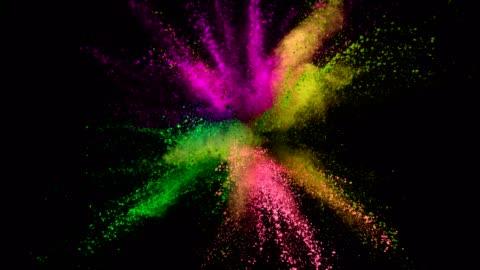 vídeos de stock e filmes b-roll de colored powder explosion on black background. - imagem a cores
