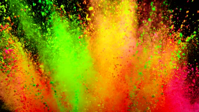 colored powder explosion on black background. - holiday background filmów i materiałów b-roll