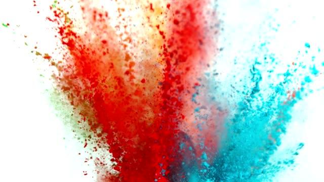 vídeos de stock e filmes b-roll de colored powder explosion on white background. - holi
