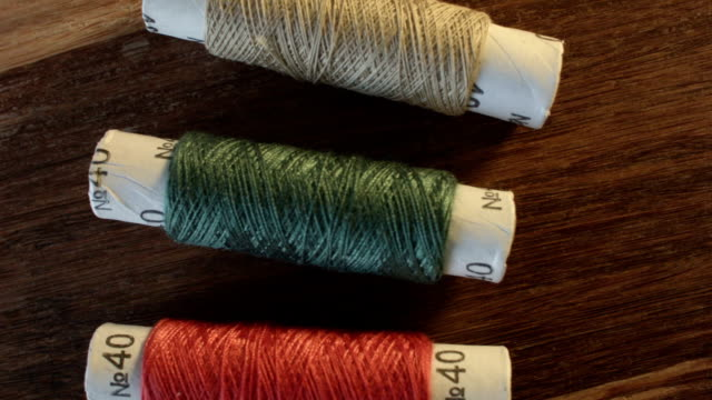 Colored sewing threads on the table video