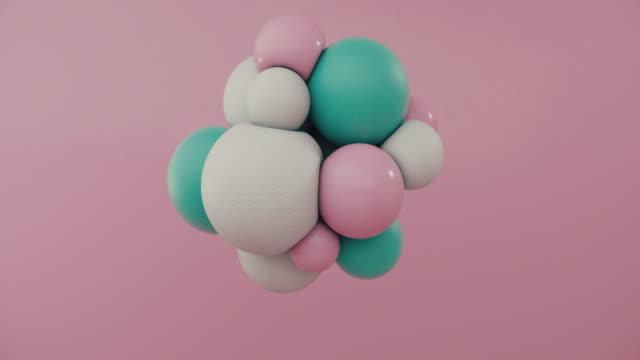 stockvideo's en b-roll-footage met gekleurde bollen die in motie drijven - driedimensionaal