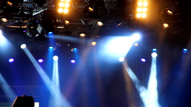 Colored spotlights at concert. Colored spotlights at concert. HD. floodlight stock videos & royalty-free footage