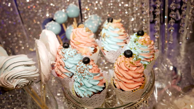 colored sweet cupcakes with cream colored sweet cupcakes with cream on a tray at the festival cooked stock videos & royalty-free footage
