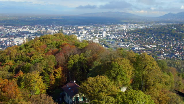 colorful autumn trees and village under the mountain Saleve video