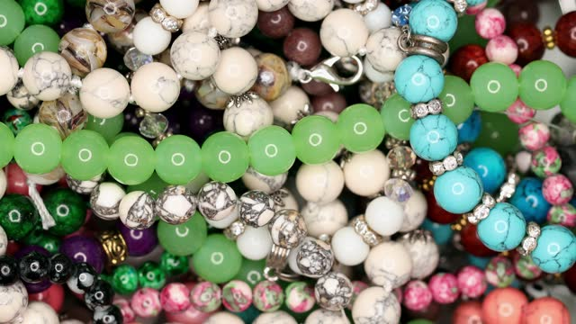 Colorful Beads Background. Multicolored natural stone beads.
