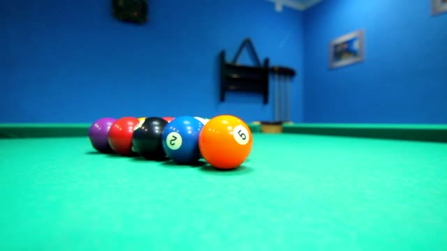 Colorful billiard balls on pool table. Game process. Billiards game starting video