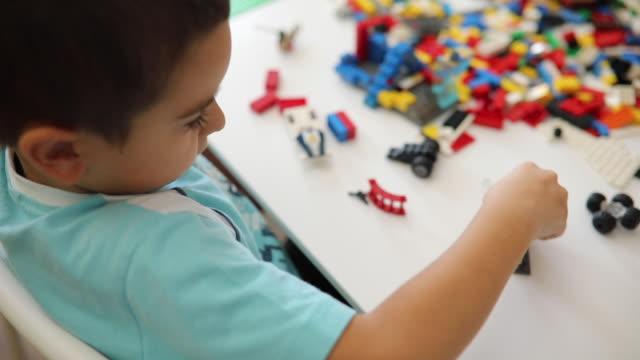 다채로운 블록 재생 시간 - 놀이 방 스톡 비디오 및 b-롤 화면