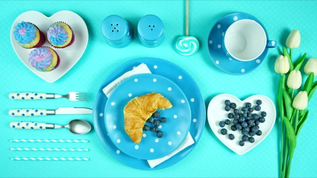 Colorful blue theme breakfast brunch table setting flatlay stop motion. Modern bright colorful blue theme morning breakfast or brunch table setting, flat lay stop motion. table top view stock videos & royalty-free footage