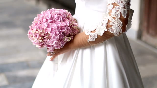 Colorful bridal bouquet Bride in white dress with a bridal bouquet / bridal bouquet / bouquet sleeve stock videos & royalty-free footage