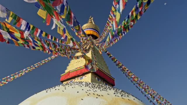Colorful Buddhist flags and the Boudhanath stupa in Kathmandu, Nepal. 4K, UHD