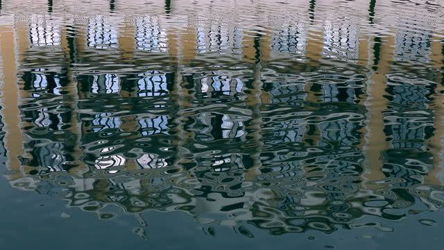 Colorful building reflection in the clear water. Ideas for background. Colorful building reflection in the clear water. Ideas for background. ocean front properties stock videos & royalty-free footage